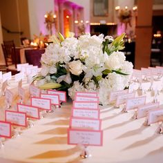 What a unique and fun way to display your guests escort cards! We love the little bells for ringing; what a sweet touch!