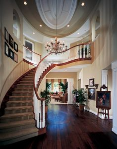 Luxury Mansions in Beverly Hills   The soaring two-story foyer of the Napoli is accented by a stylish ...
