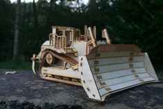 Wooden Model D11 Caterpillar Dozer The colour photo is to show you what the finished model can turn out like, your model is supplied unpainted and flat pack (as a kit). The measurements are as follows; Length 47cm (18.5 inch) Width 35 cm (13 3/4 inch) Height 19 cm (7.5 inch) There are approximately 428 pieces in this kit. Please note, this is not a beginners model and will need time and patience to build. It can be built with ease if you have some building experience. Kits; All kit...