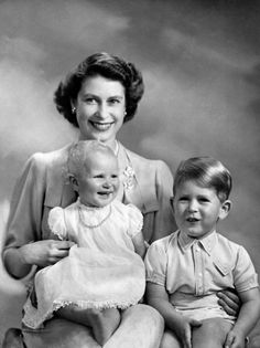 Princess Elizabeth with her children Prince Charles and Princess Anne on Anne's first birthday, taken on 15th August 1951