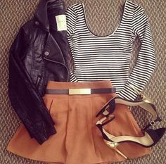 Leather jacket, long sleeved stripy shirt, skirt and high heels.