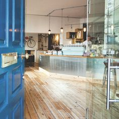 There's floorboards on the walls, left looking worn around the edges, unvarnished tabletops, and that stuff formerly known as chipboard before it became fashionable. Bits of scaffolding hold up the breakfast bar...