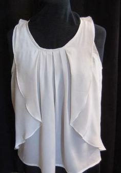 Esta blusa  confeccionada en  Crepe de seda , es delicada y exquisita al tacto. Atrevéte a realizar una como la que os traigo, porque es...