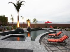 Looking for Outdoor Space and Swimming Pool ideas? Browse Outdoor Space and Swimming Pool images for decor, layout, furniture, and storage inspiration from HGTV. Outdoor Swimming Pool, Swimming Pools, Pool Spa, Raised Pools, Moderne Pools, Build A Fireplace, Luxury Pools, Pool Builders, Dream Pools