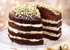 Black treacle, golden syrup and crushed honeycomb make this layered sticky ginger cake a seasonal showstopper for bonfire night. Pastry Recipes, Baking Recipes, Cake Recipes, Dessert Recipes, Baking Ideas, Bonfire Cake, Sticky Ginger Cake, Yummy Treats, Desert Recipes