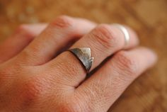 Smaller Version of the Mountain Range Ring -100% Sterling Silver -Looks great with other stacker rings -Hammered texture -Darkened for