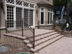Inspiring Exterior Decoration Elegant Exterior Enchanting Home Exterior Design With Using Black Exterior Impressive Front Wrought Iron Handrail Includ: Concrete Exterior Staircase Design. Outdoor Stairs Design. Small Staircase Design Together With Exterior Wooden Stair Designs. [Sipsoups. Home Decorating Pics] Home Decorating Pics