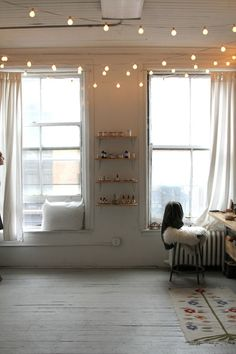 Above: String lights and sheer curtains warm up Briar's industrial workspace. | Gardenista.com