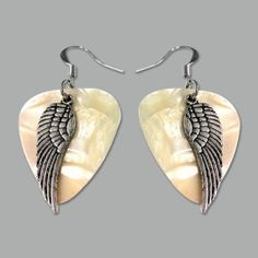 Silver feather guitar pick earrings to show off your whimsical music side with jewelry charm! Guitar Pick Jewelry, Music Jewelry, Charm Jewelry, Jewelry Crafts, Unique Jewelry, Feather Jewelry, Beaded Jewelry, Silver Jewelry, Jewelry Accessories