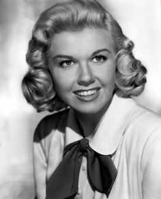 Miss Doris Day...singer, actress, the quintessential all-American girl. Whatever that means. She sang on numerous soundtracks to her own films, Doris is just as much respected in the field of singing as she is in the theatrical realm.