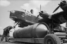 A Mark I 4,000-lb HC bomb ('cookie') is prepared for loading into Short Stirling Mark I, 'HA-D', of No. 218 Squadron RAF at Marham, Norfolk, before a night raid on Emden, Germany.