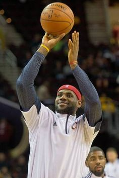 CLEVELAND, OH - OCTOBER 14: LeBron James #23 of the Cleveland Cavaliers warms up prior to the game against the Dallas Mavericks during the first half at Quicken Loans Arena on October 14, 2014 in Cleveland, Ohio. User expressly acknowledges and agrees that, by downloading and or using this photograph, User is consenting to the terms and conditions of the Getty Images License Agreement. (Photo by Jason Miller/Getty Images)