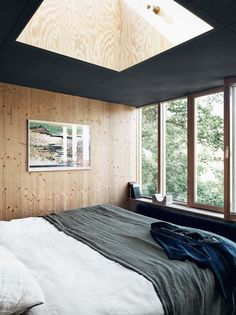 A bedroom in a striking Swedish villa built from solid wood / Photo - Jonas Ingerstedt.