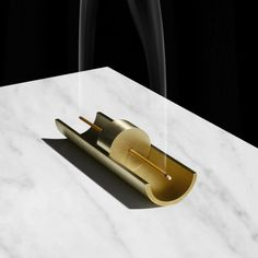 Give the gift of a home that not only looks good, but smells good, too. This brass incense holder gift set by New York's Cinnamon Projects also comes with 50 sticks with scents like amber, clove, lavender, and oakmoss. ($205)