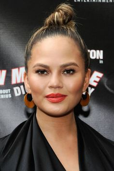 13 top knot hairstyles: Chrissy Teigen stuns in a top knot and bold earrings