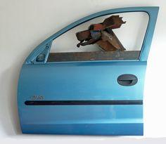 Dog in Car Door, GLS, 2011, reclaimed scrap metal by Iain Nutting