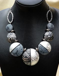 gorgeous!  Blog has lots of polymer clay jewelry