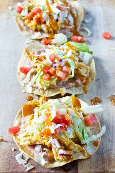 Slow Cooker BBQ Chicken Tostadas-- pulled chicken breast cooked with Trader Joe's famous Carolina Gold BBQ Sauce topped on crispy baked tostadas and veggies. This weeknight dinner will quickly become a family favorite. High protein and gluten-free.  @KristinaLaRueRD   loveandzest.com