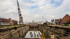 One of the many dry docks in the Brooklyn Navy Yard. The navy yard is now being used for many different things and called an Industrial Park.