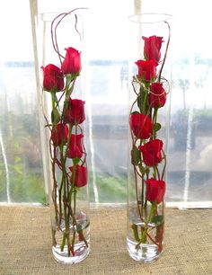 Flute of Roses is part of Beautiful flower arrangements - For a modern interpretation of a fresh rose arrangement, consider this sophisticated display of six red roses, vertically arranged with willow in a tall glass vase Beautiful Flower Arrangements, Wedding Flower Arrangements, Beautiful Flowers, Tall Floral Arrangements, Beautiful Pictures, Wedding Table Centerpieces, Floral Centerpieces, Submerged Flower Centerpieces, Centerpiece Ideas