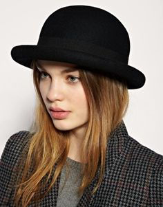 bowler hat (a hard felt hat with a round dome-shaped crown originally  created dc987eb6765