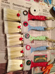 DIY Santa Brush Ornament. Dollar store brush, acrylic paint, googly eyes, pipe cleaners, pompoms, hot glue gun and christmas charms.