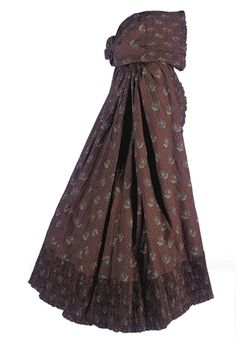 A fine chintz cloak 1790s, chocolate brown chintz with a cream and turquoise floral print, the hood and edges deeply pleated, and lined in cream flannel with a scarlet floral print and a tan print cotton. Christies