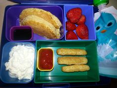 Kid Bento Lunch -Coconut Flour Pancake w/ Blueberry Syrup -Strawberries -Apple Beet Sauce (in Squooshi) -Cottage Cheese -Fish Sticks w/ Ketchup