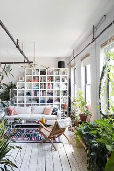 Modern Bohemian Living Room In A Loft Featuring Cube Bookcase Storage And Lots Of Plants Global Decor Decorating Ideas Decorations For Baby Shower Modern Bohemian Living Room Inspiration Ideas - theateraudio Living Room Designs, Living Room Decor, Living Spaces, Living Rooms, Living Walls, Bohemian Style Home, Bohemian Living, Modern Bohemian, Bohemian Room