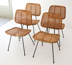 This set of four chairs is made from iron structures with rattan seat and back rests. They were produced in Italy in the 1950s.
