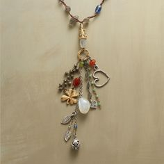 REVELS NECKLACE--Our merrymaking mix of gemstones and charms includes carnelian, peach moonstone, labradorite, kyanite, rainbow moonstone, chrysoprase and peridot. Sterling silver hearts and leaves and a 14kt vermeil four-leaf clover for luck. Macrame strand