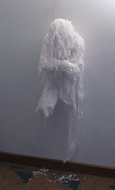 """Using trash bags, unused grocery bags and plastic sheets, Pakistani artist Khalil Chishtee creates life-sized figures wracked with emotion. He uses these materials as a metaphor for """"recycling our identities"""" or braving the problems of life."""