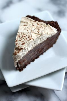 Malted Chocolate Pudding Pie with Chocolate Animal Cracker Crust and Kahlua Whipped Cream - This pie is CRAZY good! So decadent and surprisingly simple to make.