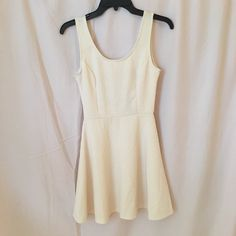c00b3118100 cream skater dress from windsor. doesnt have a tag with a size but it would