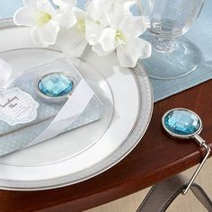 These sparkling blue purse hooks make great guest favors that are both fun and functional, and are a great way to show your appreciation to your bridal party!