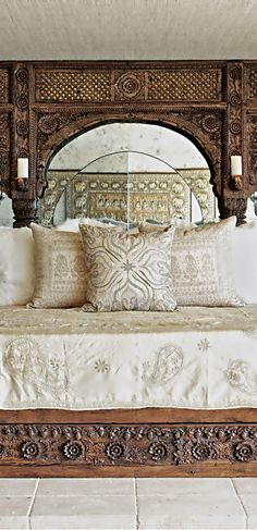 Cher's home in Sierra Hills. Beautiful combination of carved architectural salvage and rough white linens.
