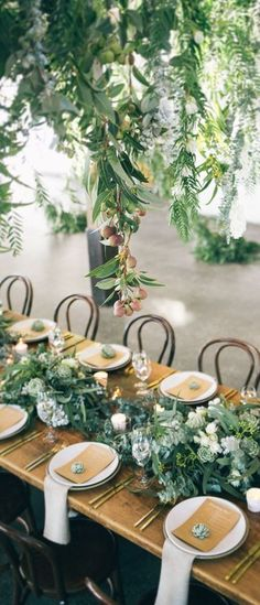 Style Co gorgeousness.. green foliage, gold cutlery and hanging installation - wow!