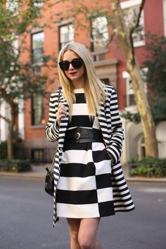 Street Style: Love the wide corset belt by @Ann Flanigan Taylor that breaks up this striped look. Click to shop it now!