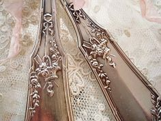 Vintage silver: really charming pattern, the back is as interesting as the front.  Unfortunately the original site is in Chinese, for me at least, indecipherable as to pattern name and maker.  See additional pin for back view.