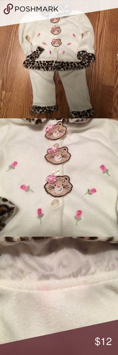 Adorable girls fleece cat sweatsuit Jacket washed but never worn. Pink stain in back by collar. Button down. Pants worn a few tomes slight pilling and small stain as pictured. Matching Sets