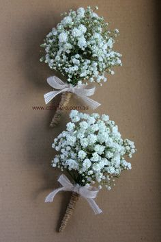 Babies breath corsages with twine binding and rustic ribbon.