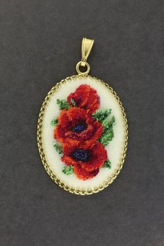 """A """"Poppies"""" pendant made in Petit point technique"""