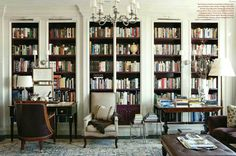fabulous library by Thomas O'Brien. A great non-yellow, but warm white for north facing rooms is Benjamin Moore OC-122 Cotton Balls