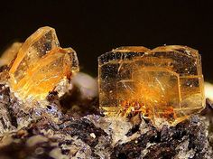 Clinoptilolite-Ca  Locality: Barranco de Tocodoman, La Aldea de San Nicolás, Gran Canaria (Grand Canary), Las Palmas Province, Canary Islands, Spain Transparent orange crystals of clinoptilotite-Ca on...