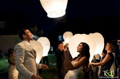 Paper lanterns for Exit.  ~Uptown Weddings & Events, LLC. (Event Planning and Design Services) ~ Thomas and Penelope (Photography)