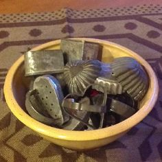 Old Yellow Ware Bowl...filled with prim tin heart molds & cutters.