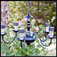 Have a poorly lit trouble spot in your yard? Convert an old electric chandelier into a beautiful, solar-powered outdoor lighting fixture!