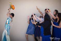 Throwing the bouquet. Hispanic Cultural Center in Albuquerque, New Mexico. Matt Blasing Photographer. Albuquerque, New Mexico Wedding Photographer. www.mattblasing.com