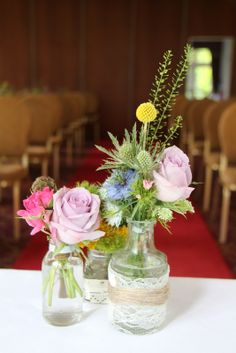 On the Registrars table jam jars filled with hand picked blooms took centre stage