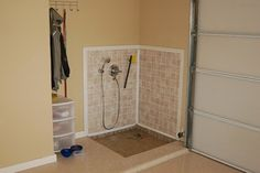 Garage dog wash. Good idea if you don't have room in your home for a dog shower.